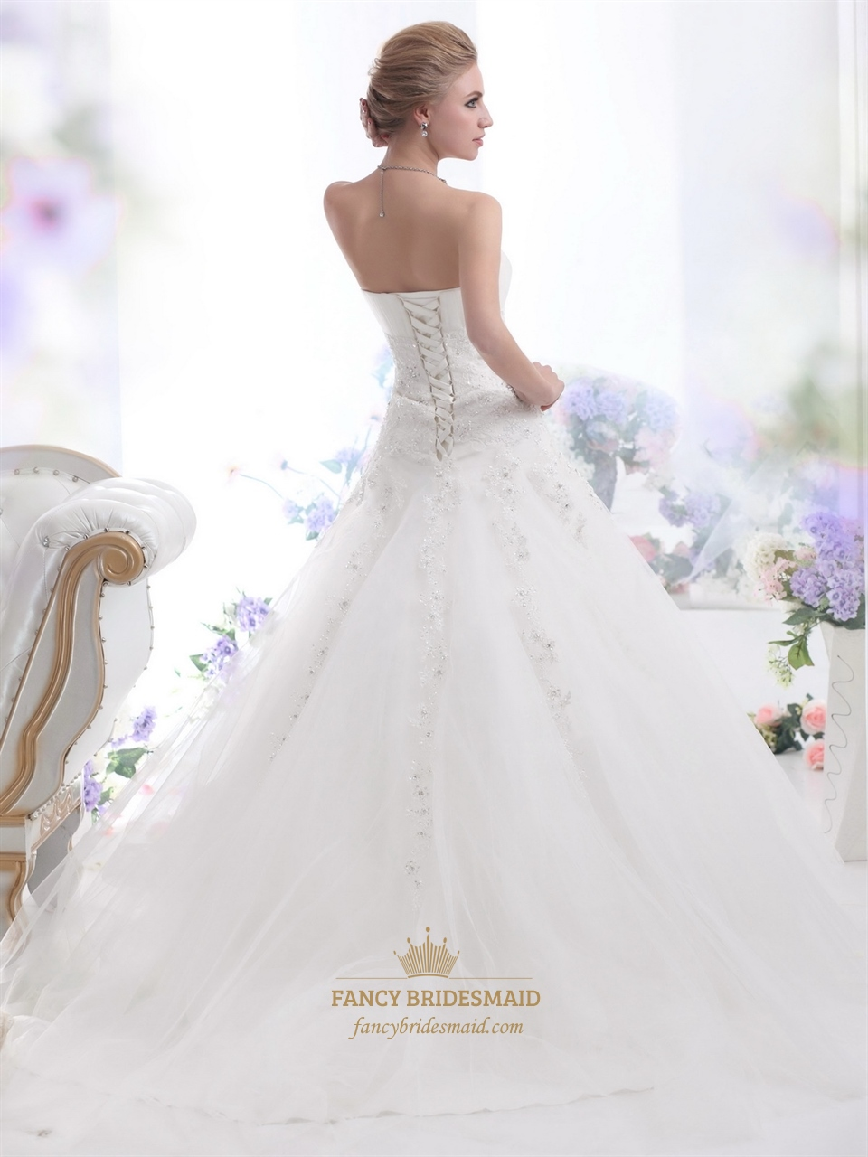 Ivory strapless tulle ball gown wedding gown with beaded for Strapless beaded wedding dresses