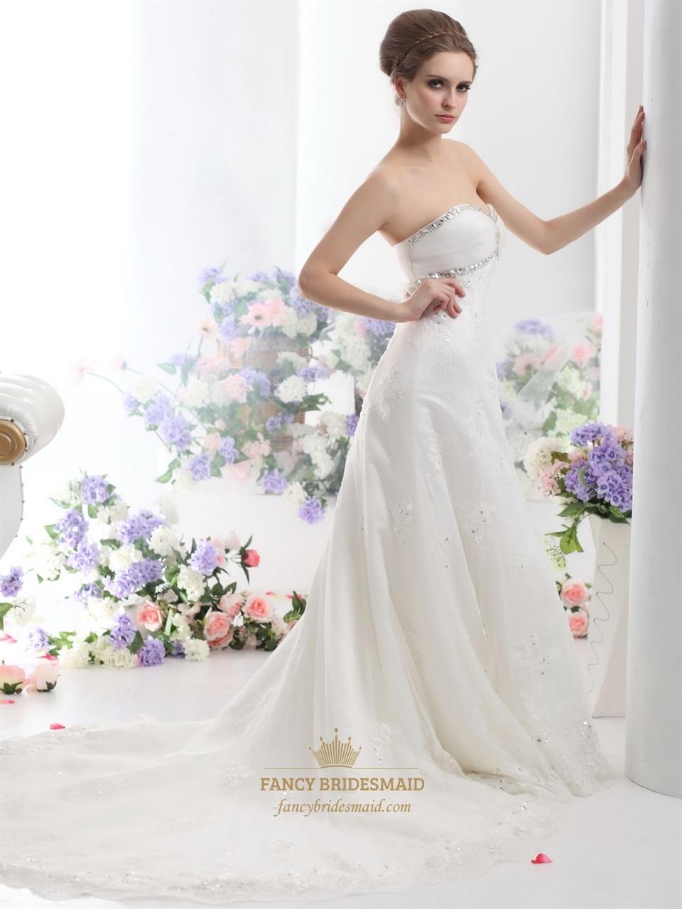 Ivory strapless beaded tulle wedding dresses with semi for Strapless beaded wedding dresses