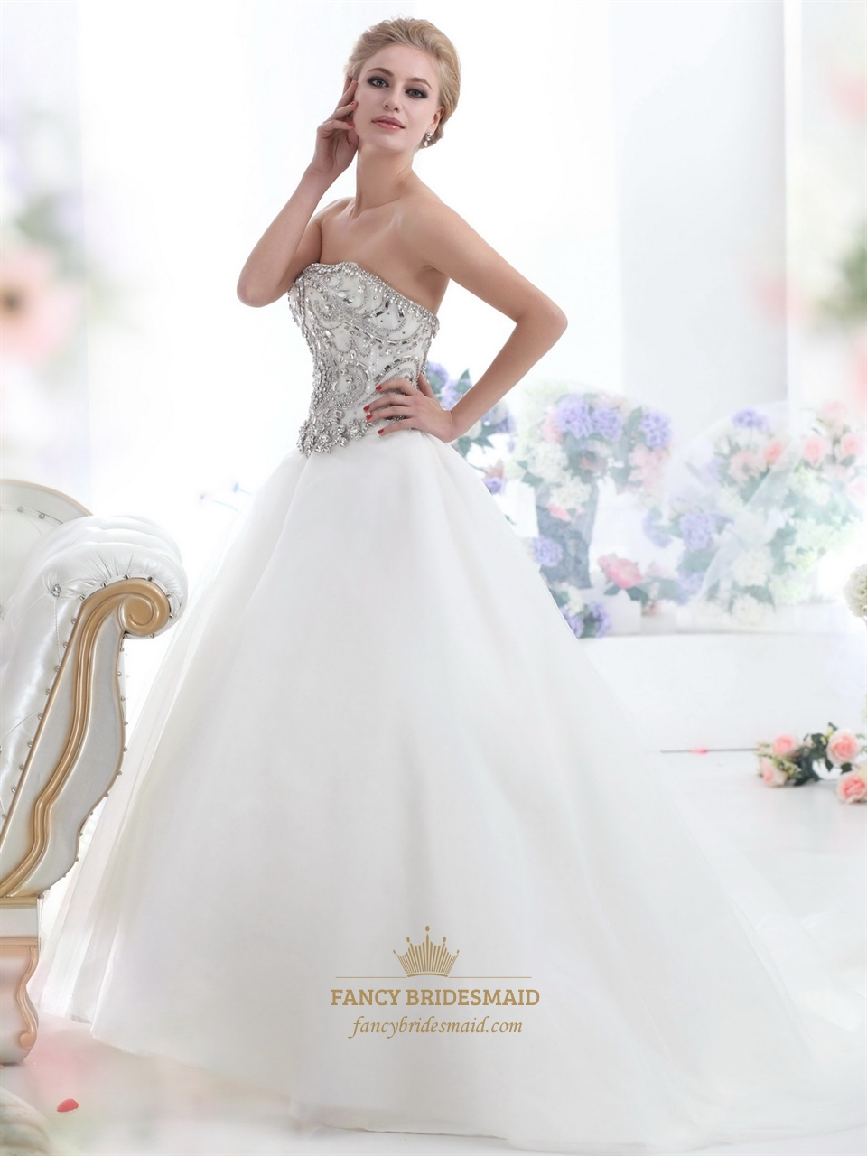 Ivory strapless heavily beaded bodice chapel train tulle for Heavy beaded wedding dresses