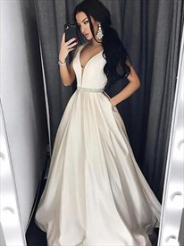 A Line Ivory Sleeveless Beaded Satin Prom Dress With Pockets