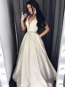 A Line Ivory Sleeveless Beaded Satin Prom Dress With Pockets